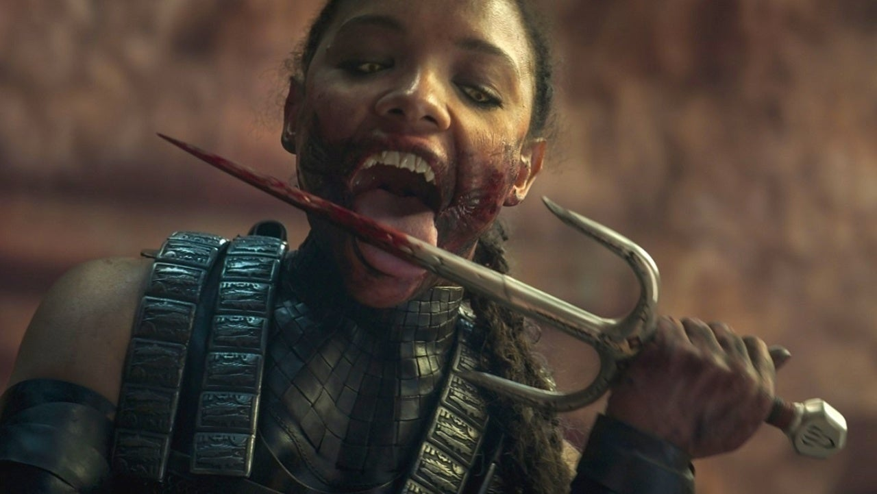 Mileena is seen licking her blades.