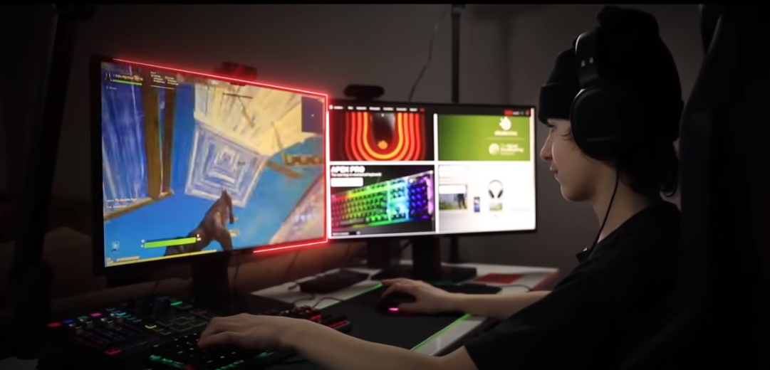 FaZe H1ghSky1 plays Fortnite on his computer using duel monitors and SteelSeries gear. Fortnite is on the left and SteelSeries store is on the right.
