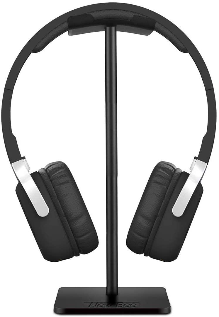A simple black headphone stand doing its job - holding headphones.