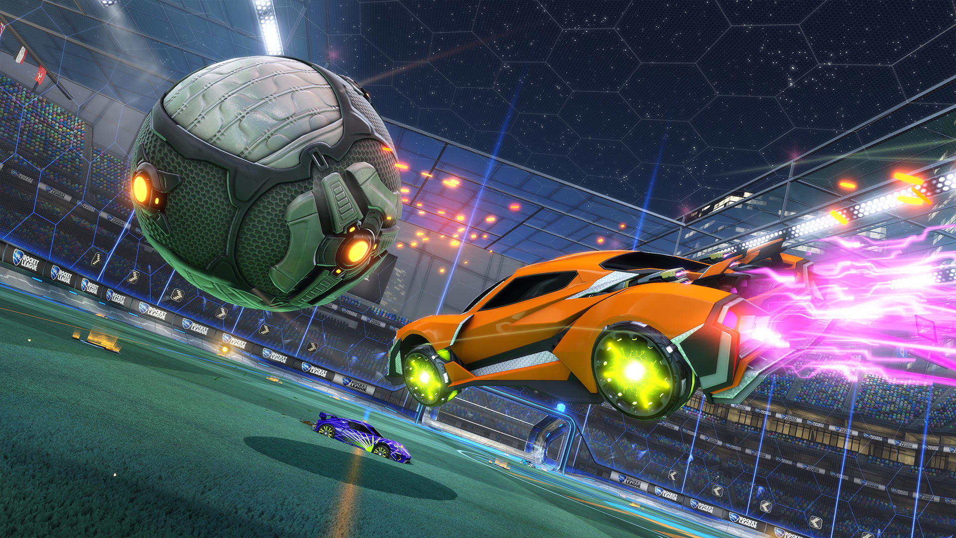 A screenshot from Rocket League featuring a rocket powered orange car pushing a giant ball in a stadium