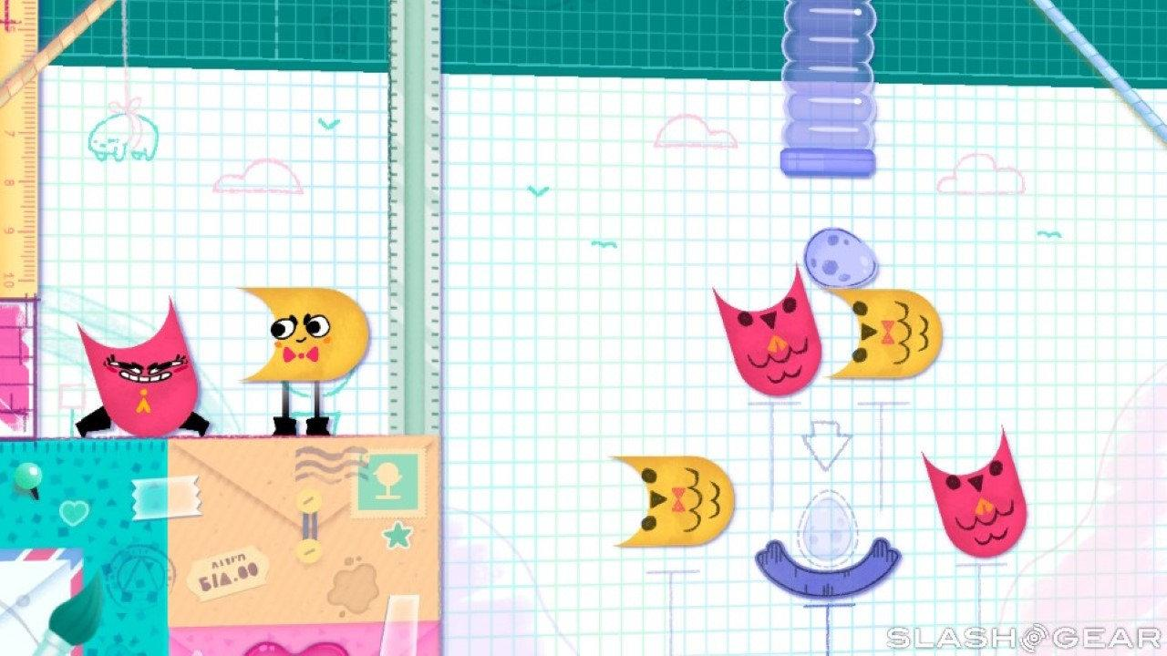 Colorful paper characters stand on a game level made to look like a desk with graph paper and rulers
