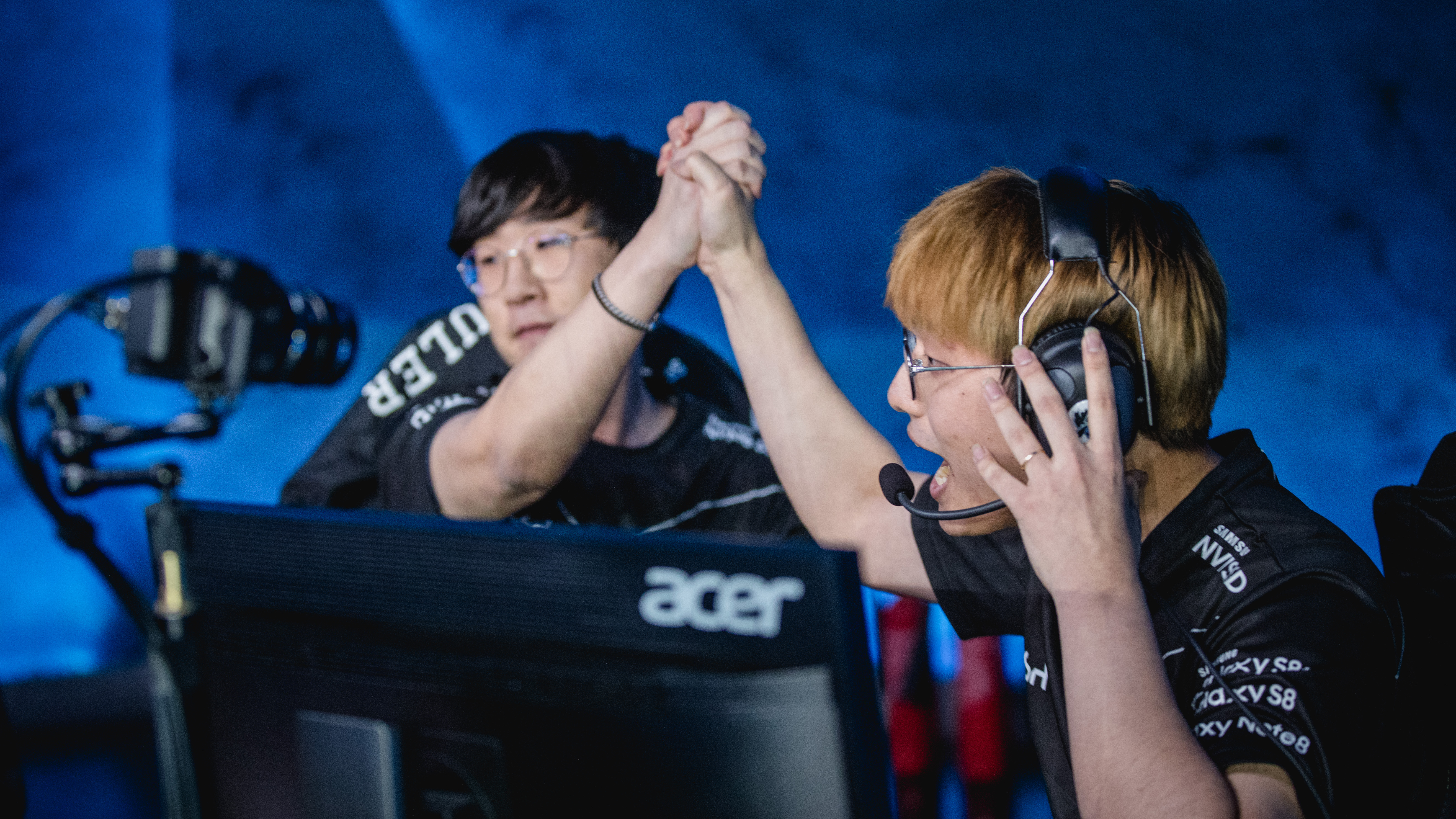 Two professional League players high fiving after a game