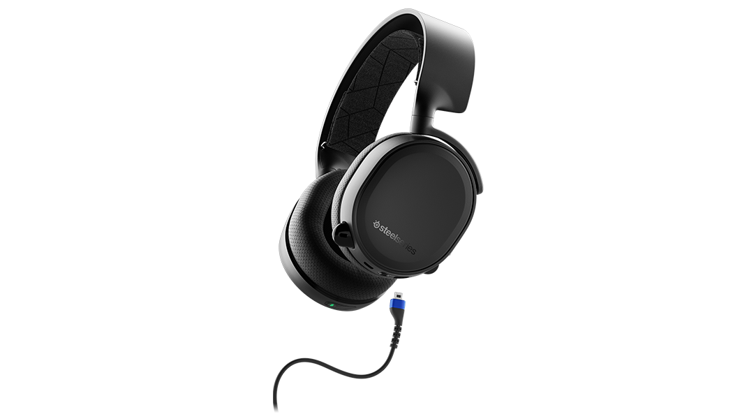A view of the Arctis 3 Bluetooth Headset with the cable it uses to sync and charge.