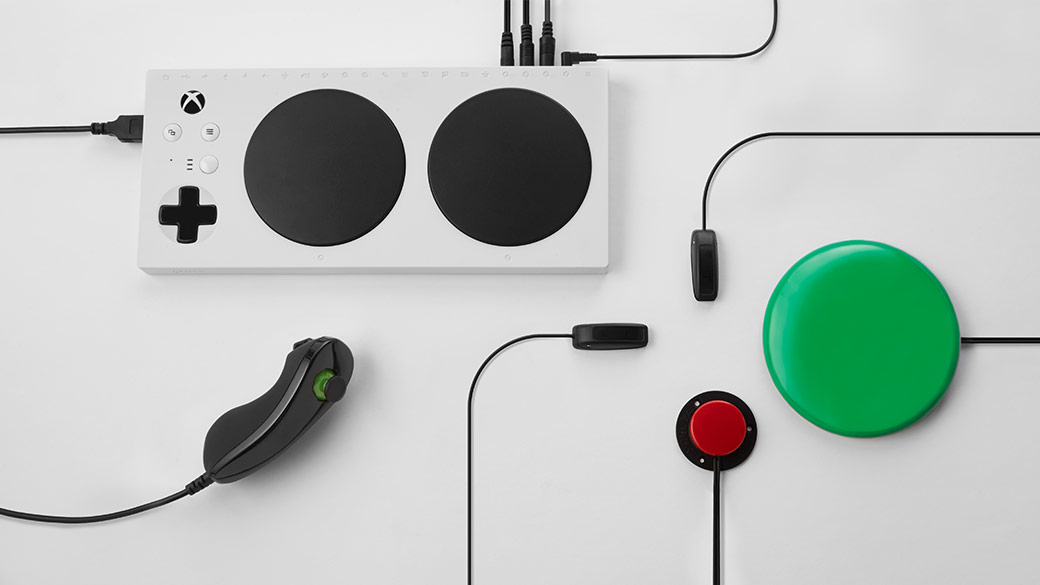 Xbox Adaptive Controller in white with various buttons and joysticks attached by wires