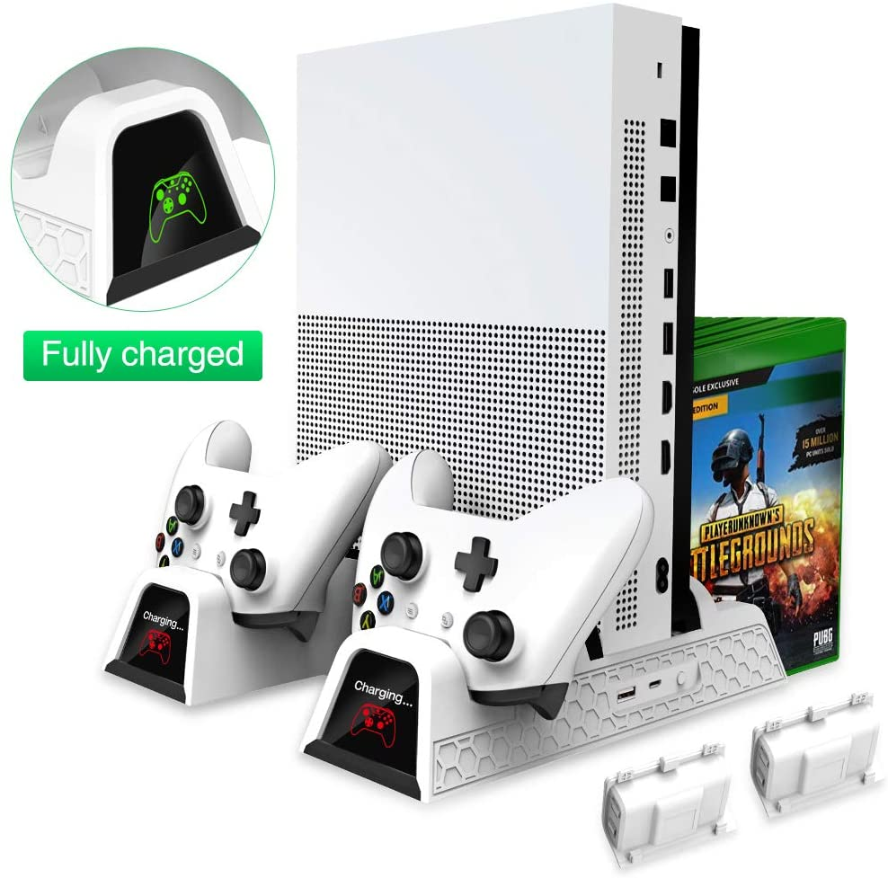 "OIVO brand vertical Xbox One cooling stand with a white Xbox One and matching controllers. A PlayerUnknown's Undergrounds game case is shown in the storage area. The controllers are positioned upsidedown in the station with ""charging"" shown on the display in red."