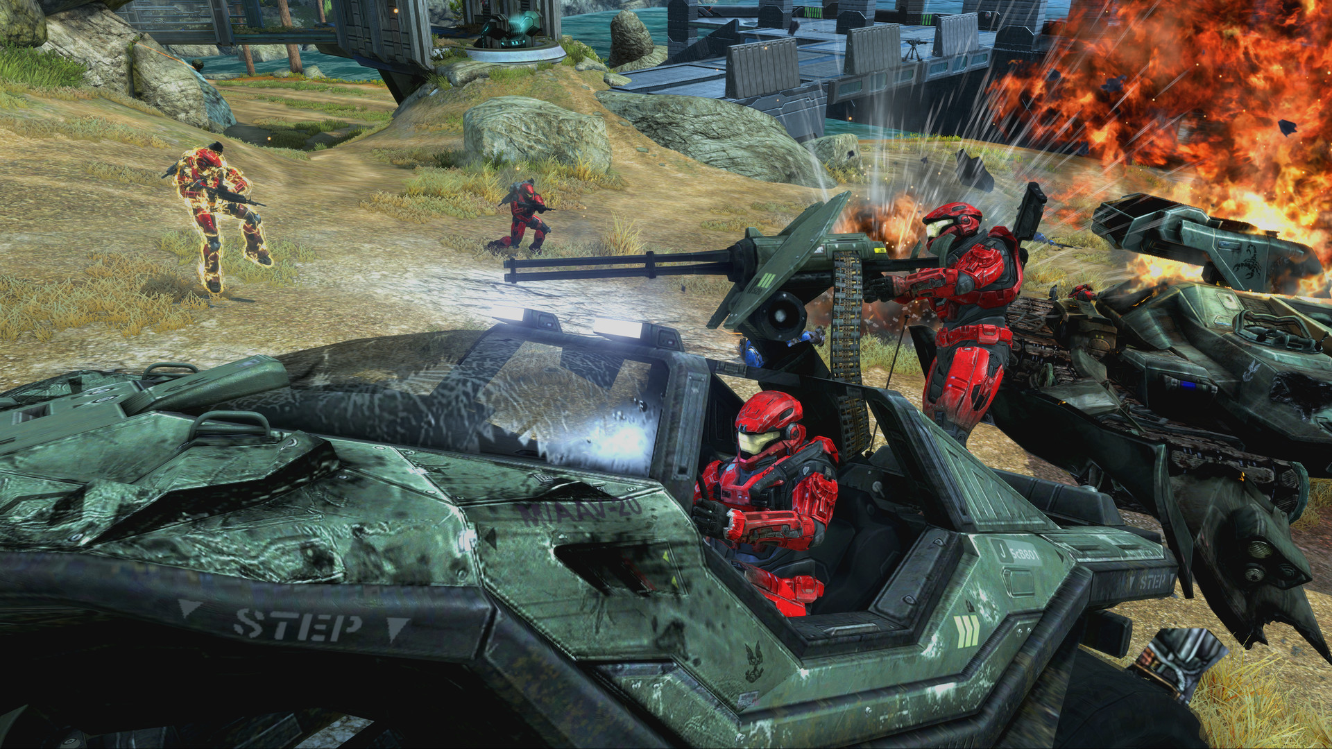 Two red Spartan players antagonize another character from their Warthog in Halo multiplayer.