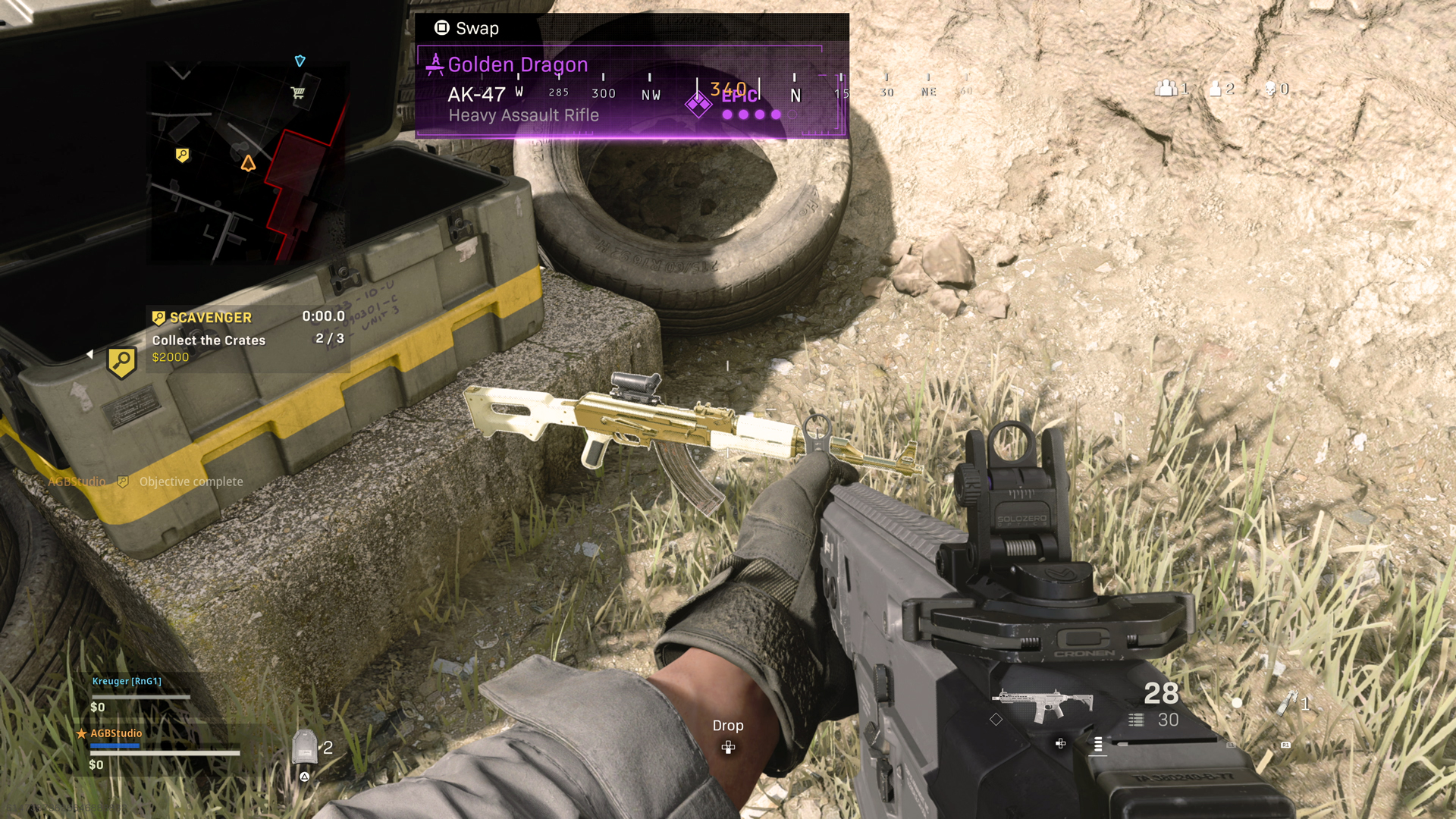 "A hand holding a rifle points at a highlighted rifle on the ground. A heads up display shows a rifle and 28/30 rounds. A directional pad symbol is displayed at the bottom of the screen with the word ""drop,"" and the top directional button highlighted. A purple box above the rifle features a square symbol with the word ""swap"" and a description: ""Golden Dragon, AK-47 Heavy Assault Rifle."" An open supply crate lays on the ground next to the AK-47 with a hovering text box. There is a magnifying glass symbol with the word ""Scavenger"" next to it, followed by ""Collect the Crates 2/3, $2000."
