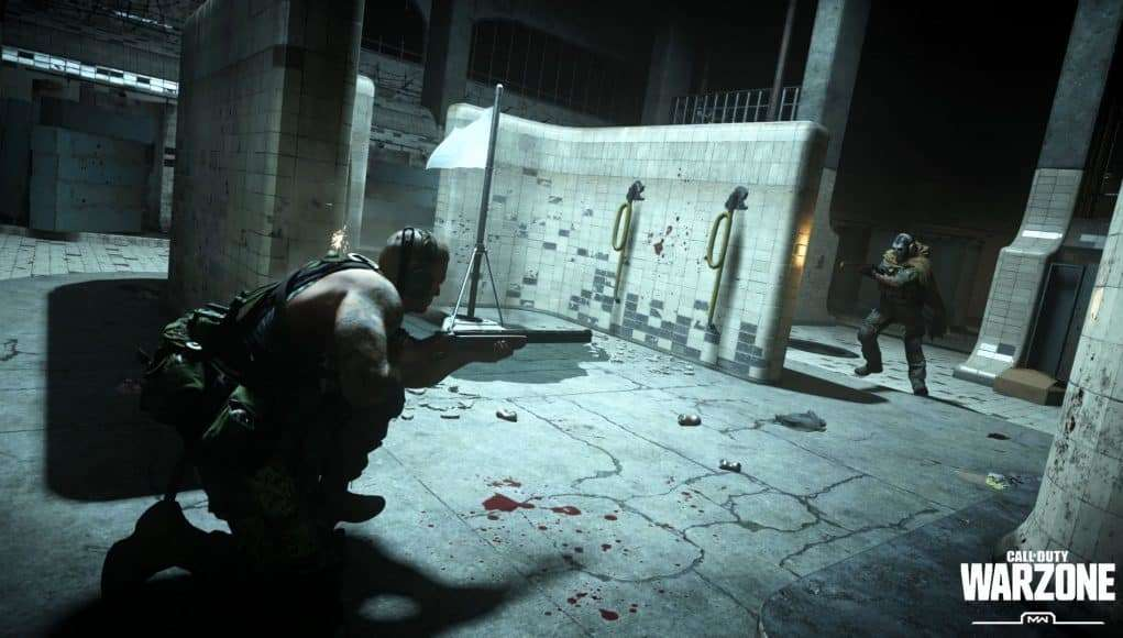 "Two soldiers square up to fight in a desolate shower room. A logo reads ""Call of Duty Warzone, MW"""