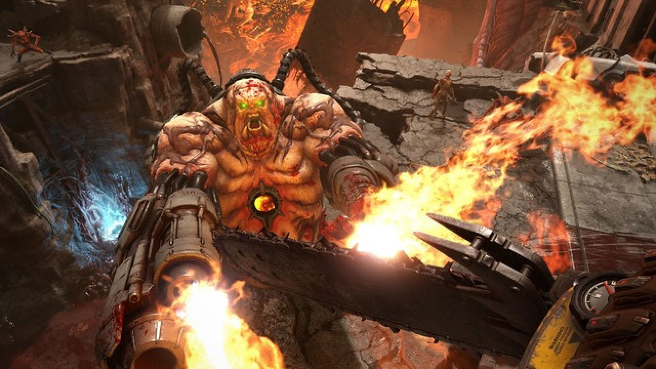 A chainsaw is held at the ready in a hellish world as a large demon with firing guns for hands lunges toward the camera.