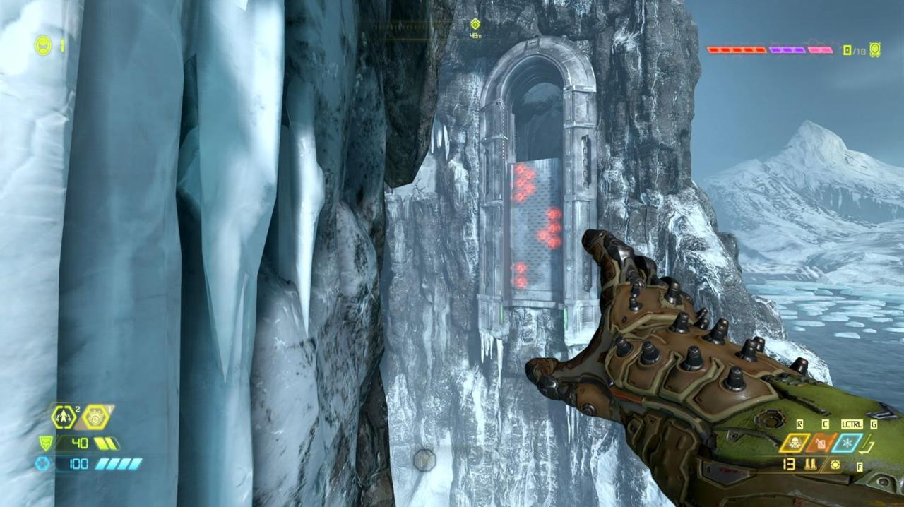 An armored hand reaches out to a doorway in the distance, protruding from the side of an ice-covered cliff. Below the door are three groups of glowing red circles.