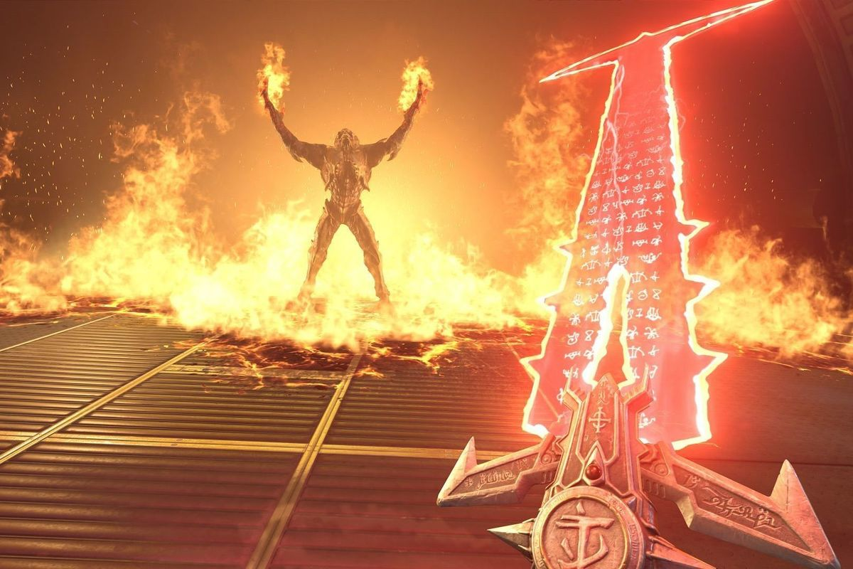 A large demon raises his arms, fire shooting out of his hands and all around him on a metal platform. An intricate sword is held from a first person's point of view with a long, angular blade made of red light and glowing symbols.