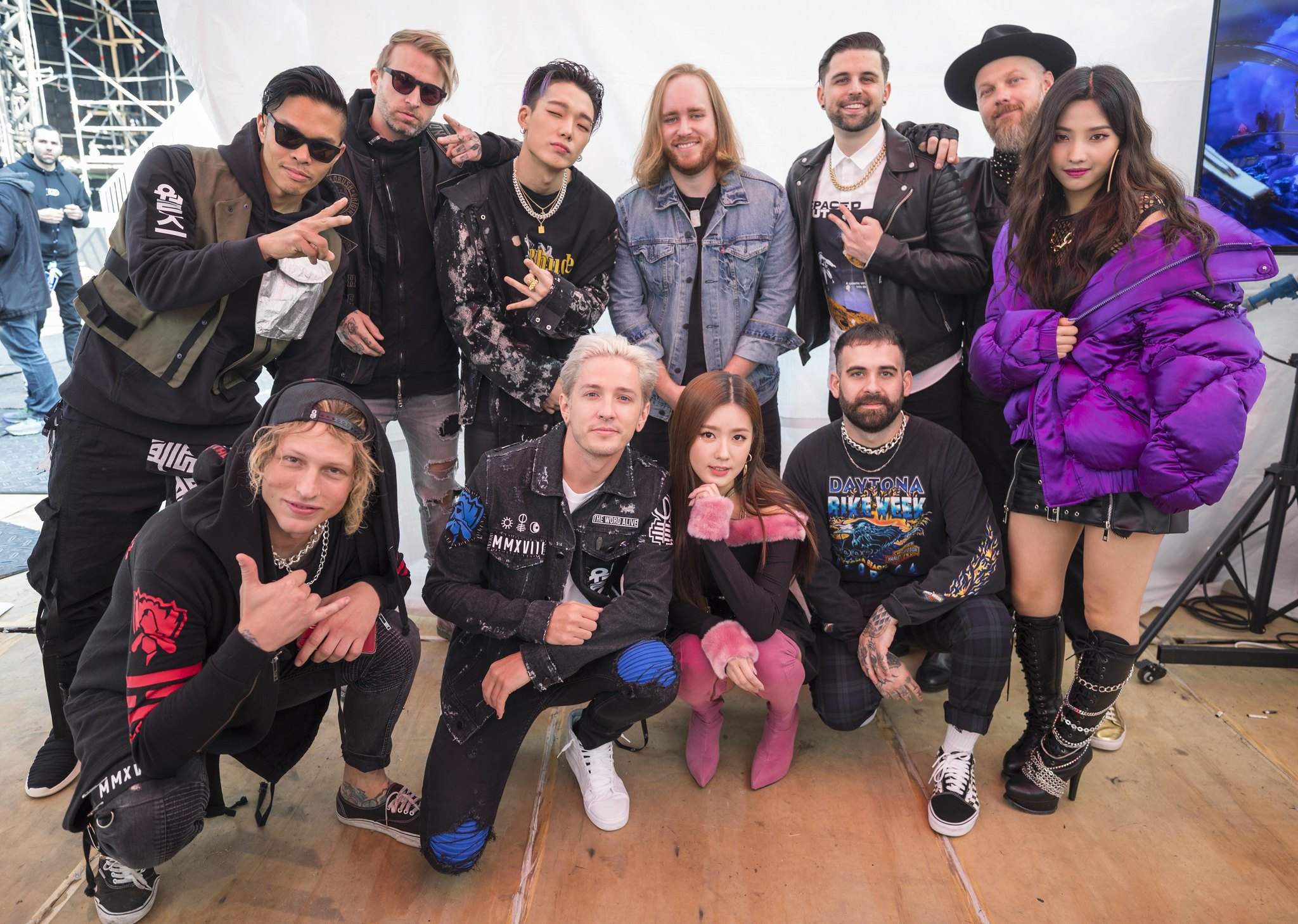 "A group photo of ""The Glitch Mob"" and K-pop stars from Worlds 2018"