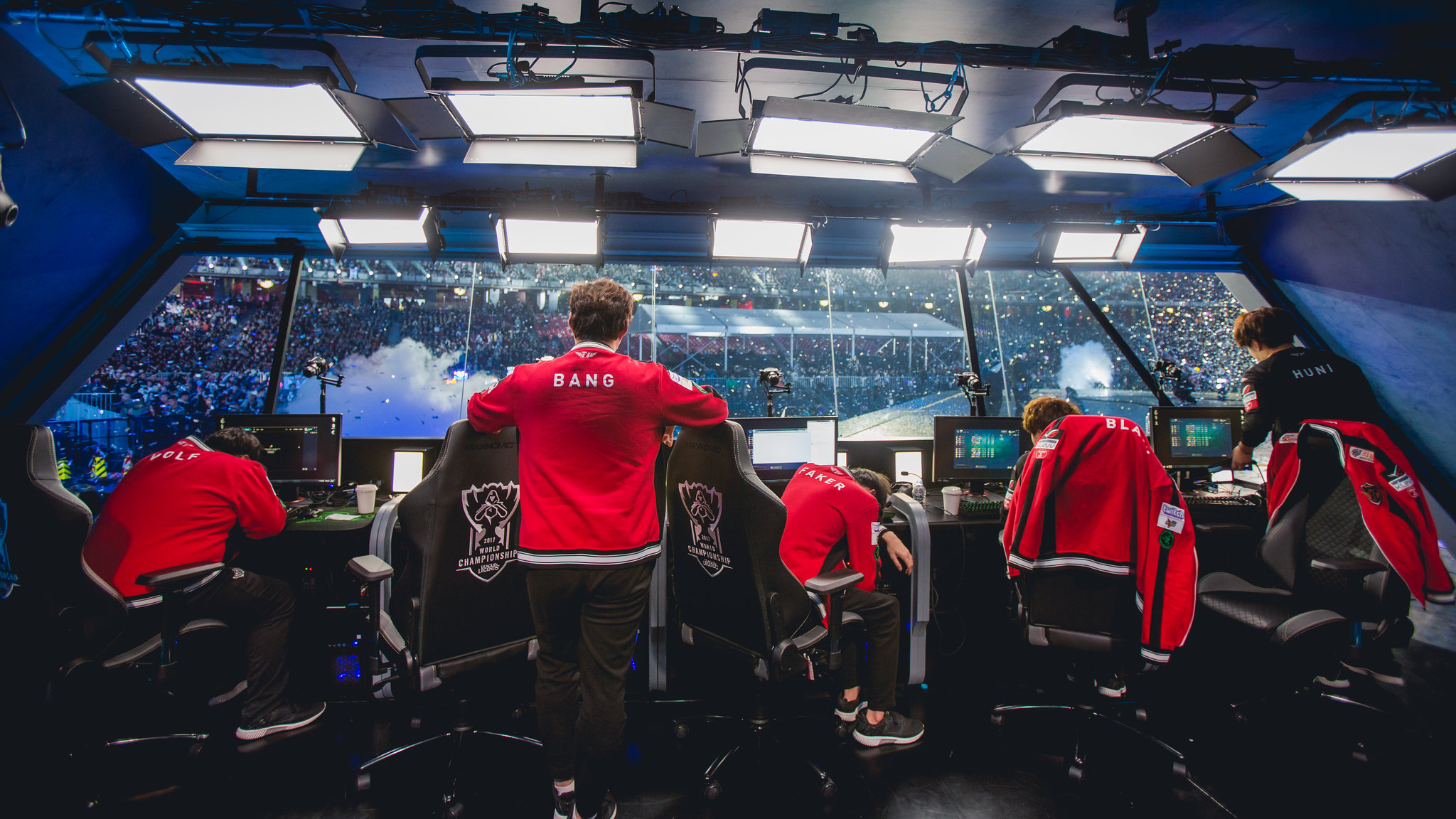A team of League of Legends players inside their tournament booth at Worlds