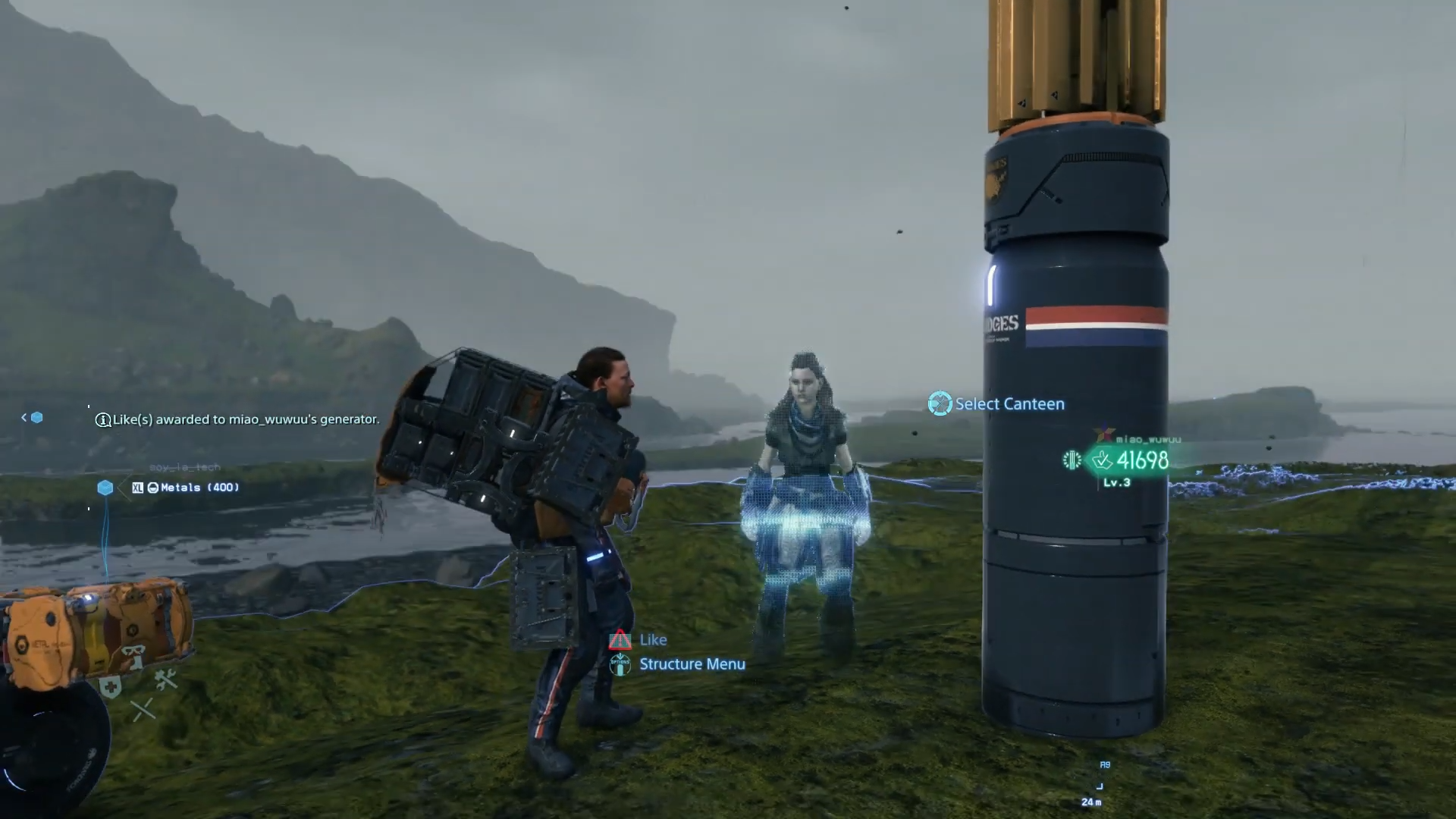 Sam stands by an Aloy hologram on the main field map