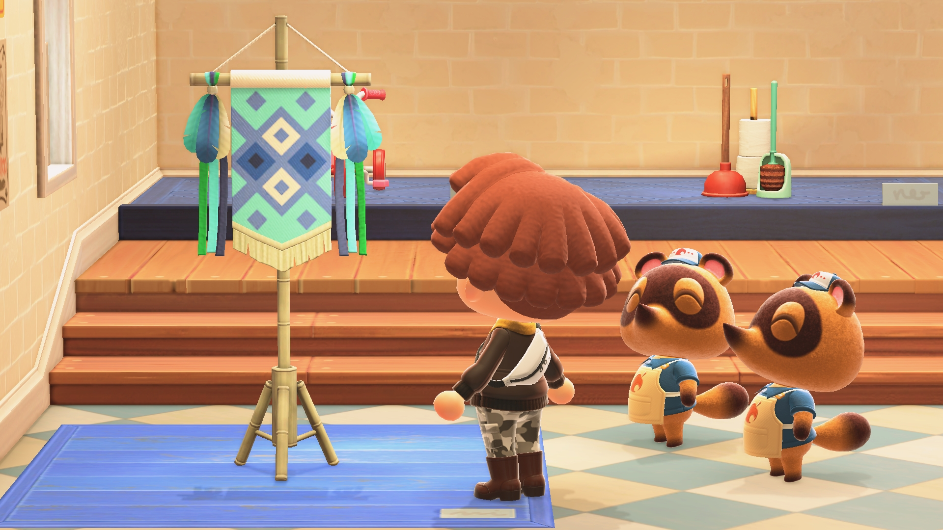 Timmy and Tommy Nook look on as a villager peruses the seasonal Festivale items.