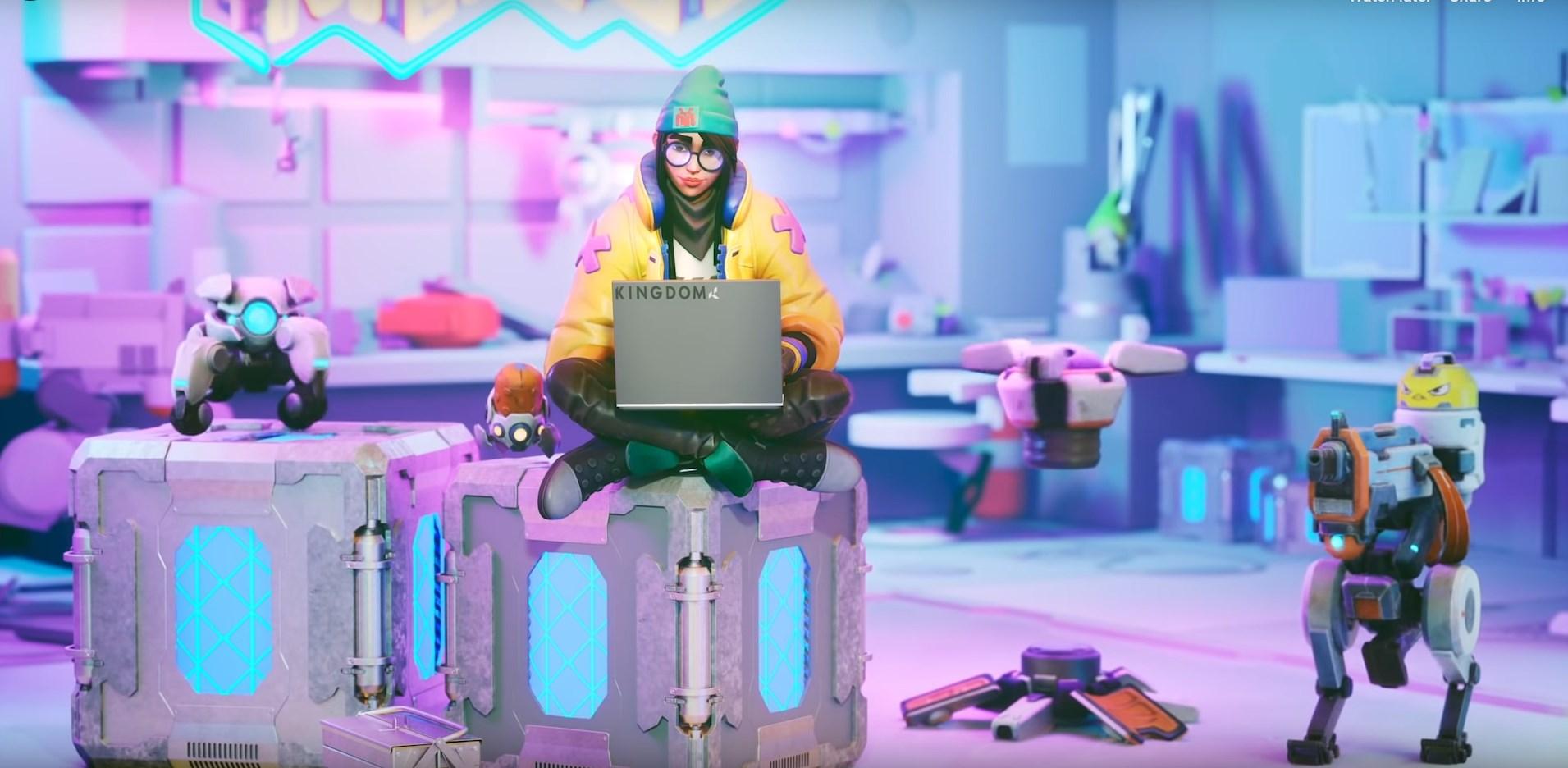 Killjoy on a laptop surround by her robots