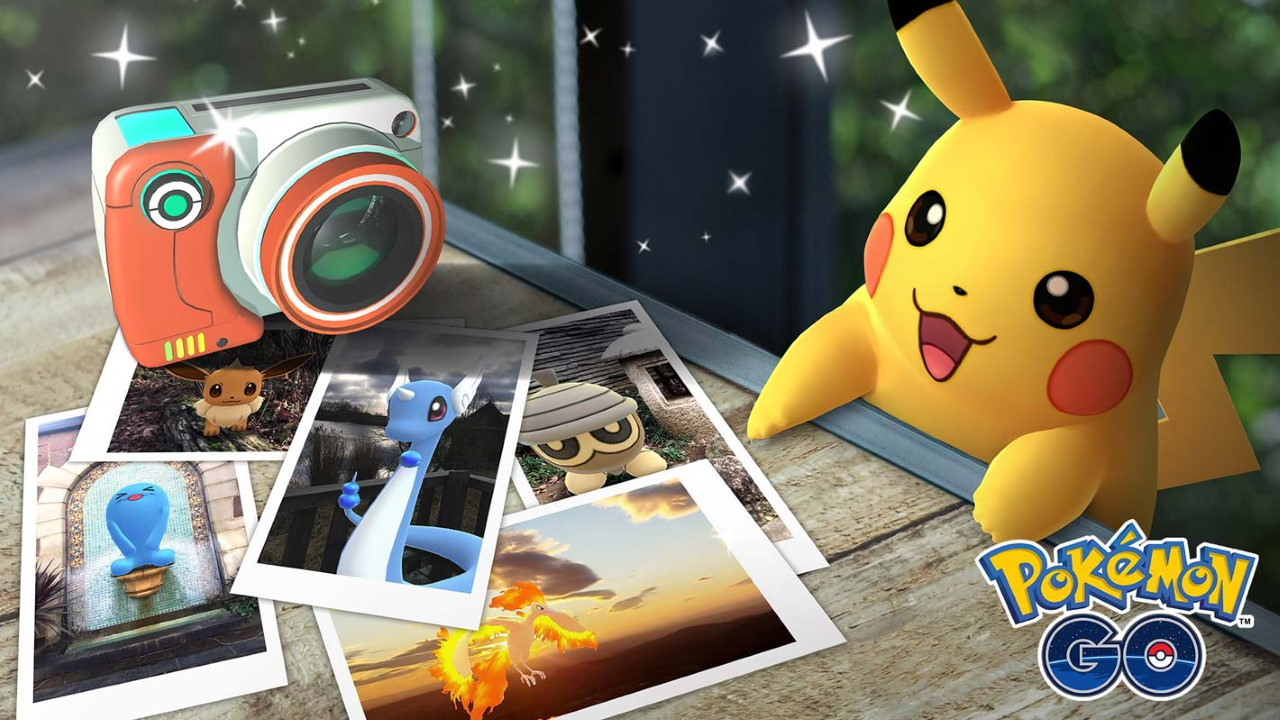 Pikachu hangs out with photos and a camera.