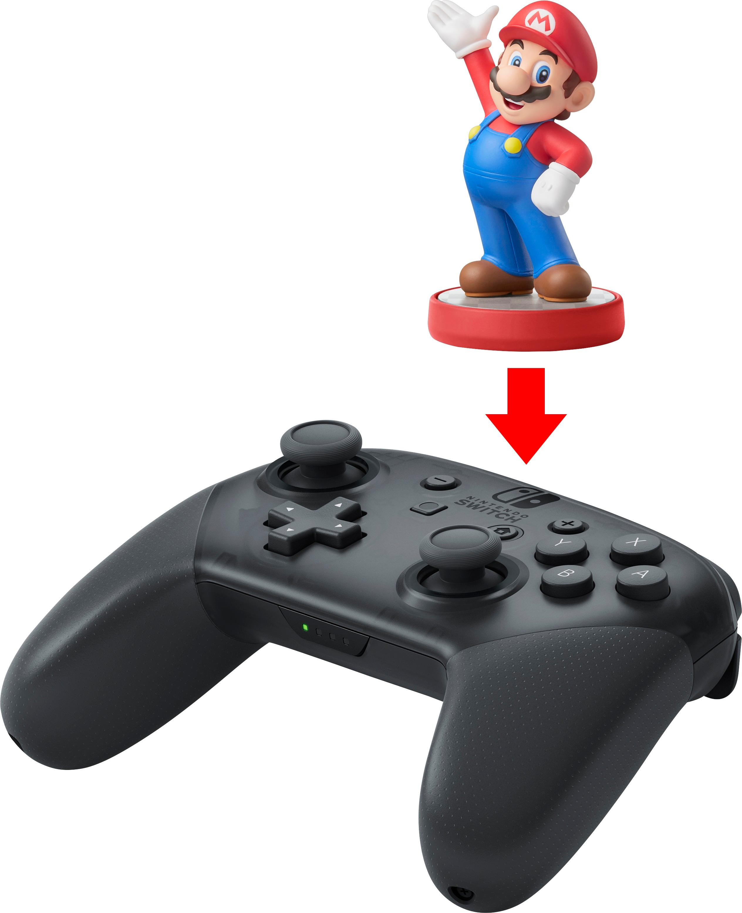 A Mario amiibo sitting atop the location of the Pro Controller's NFC reader.
