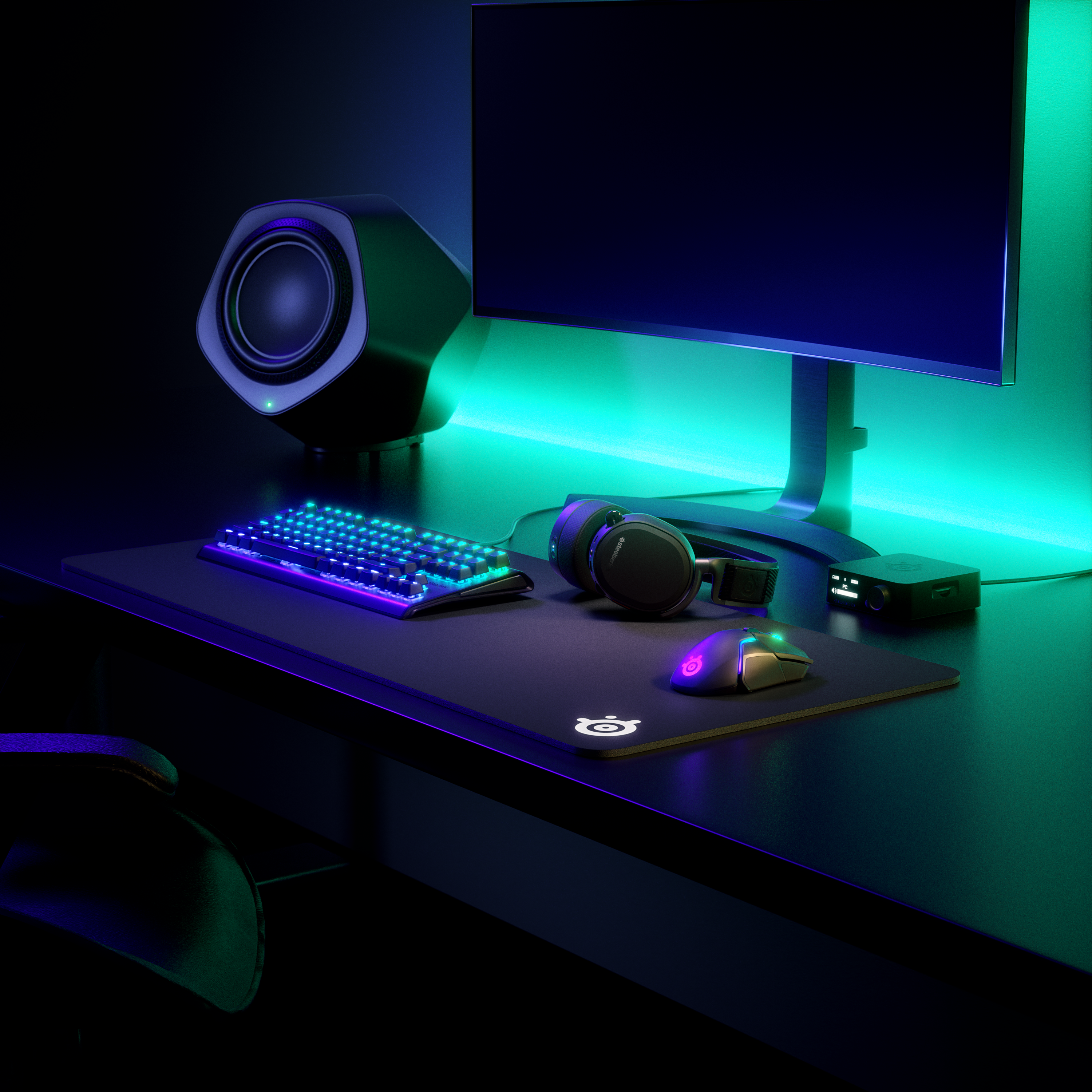 Various RGB SteelSeries products at a gaming desk