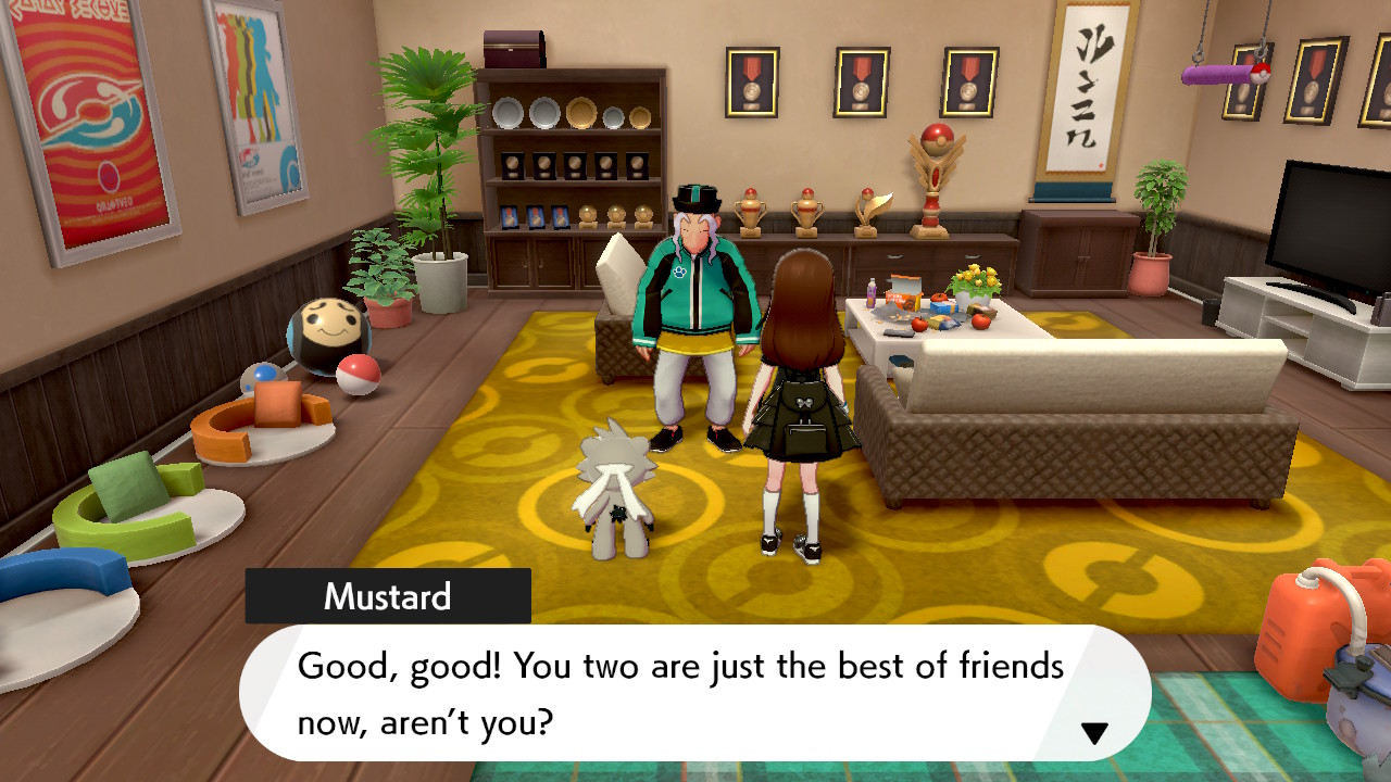 A female Pokemon trainer and Kubfu meet Mustard at the Master Dojo to check Kubfu's friendship rating.