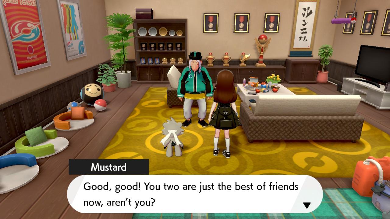A female Pokemon trainer and Kubfu meet Mustard at the Master Dojo to check Kubfu's friendship rating.