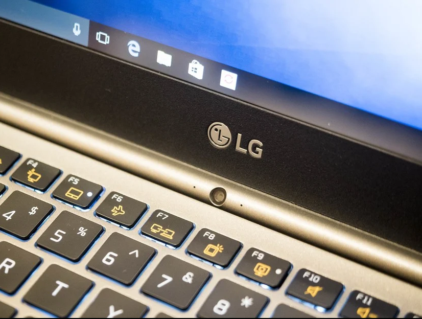 Zoomed in image of an LG laptop with a small microphone hole at the bottom of the screen