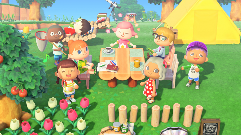 8 characters in Animal Crossing sitting around a table outside a tent