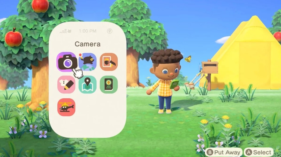 "A male, brown-skinned video game character looks at a mobile phone. A menu is overlayed on the left, displaying icons. A hand-shaped cursor hovers over a camera icon. The word ""camera"" is displayed at the top of the menu. Two options are displayed in the bottom right corner of the screen: B Put Away, and A Select."