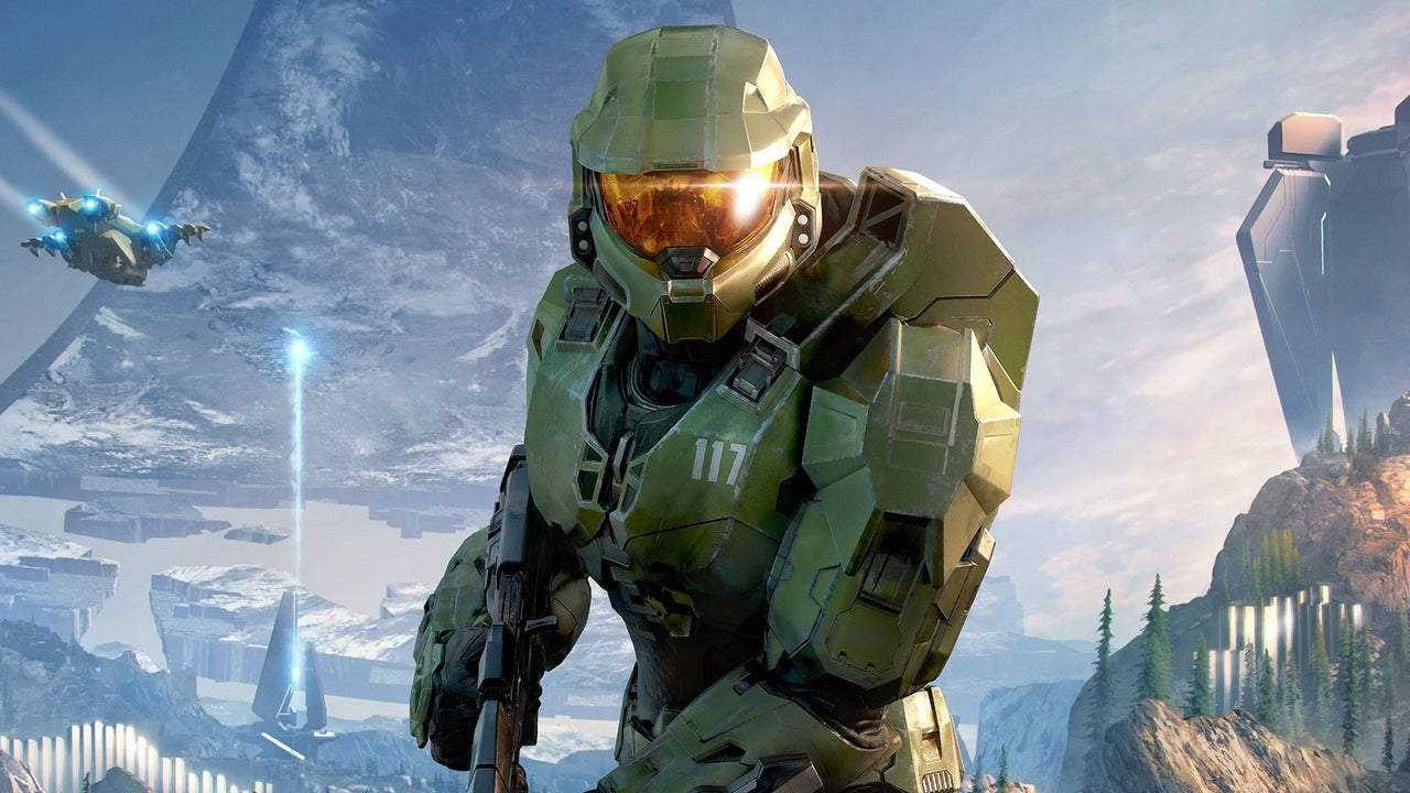 Master Chief stands proud beneath a Halo ring, ready to strike.