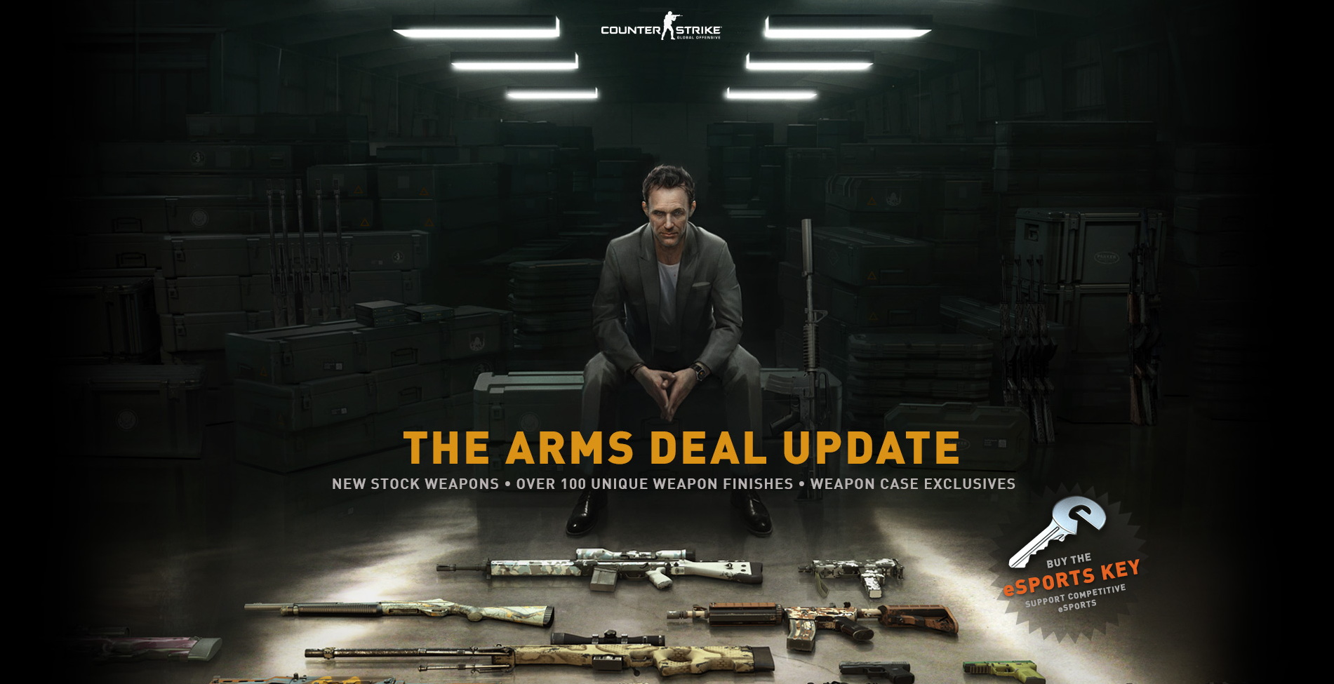 """A serious man sits on a large weapons crate, under which reads """"The Arms Deal Update: New Stock Weapons, Over 100 Unique Finishes, Weapon Case Exclusives. On the floor in front of the man are several rifles and pistols with various colored patterns on them. A picture of a key and call to action reads: Buy the esports key support competitive esports. A logo at the top of the picture reads Counter Strike Global Offensive"""