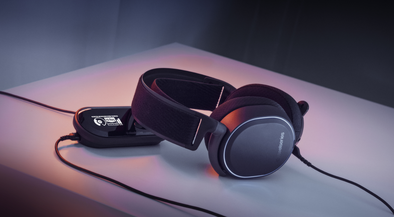 Arctis Pro + GameDAC headset laying on a table