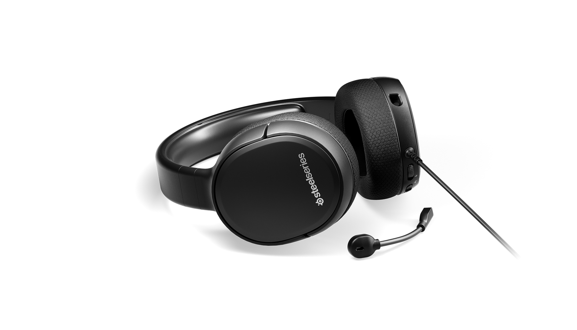 Arctis 1 gaming headset on surface with microphone detached.