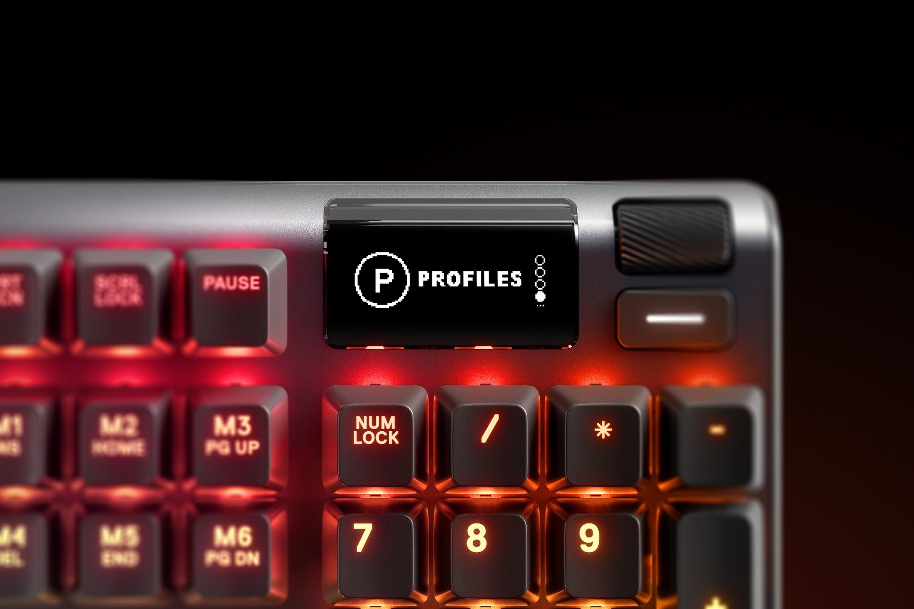 Zoomed in view of the multimedia and settings controls/volume roller on the French-Apex 7 (Red Switch) gaming keyboard