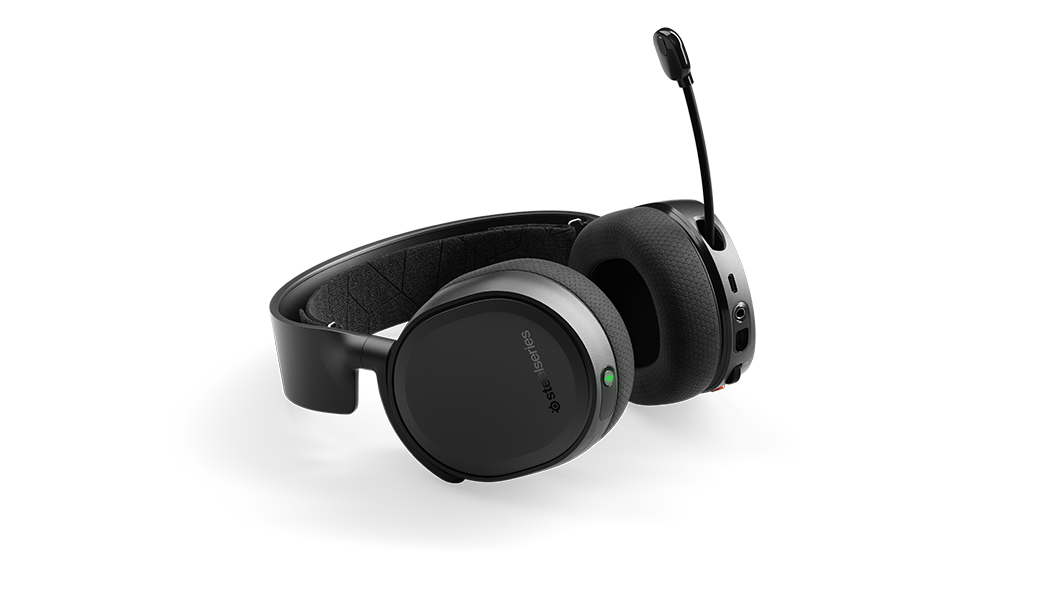 Arctis 3 Bluetooth wireless gaming headset angled on surface with microphone extended