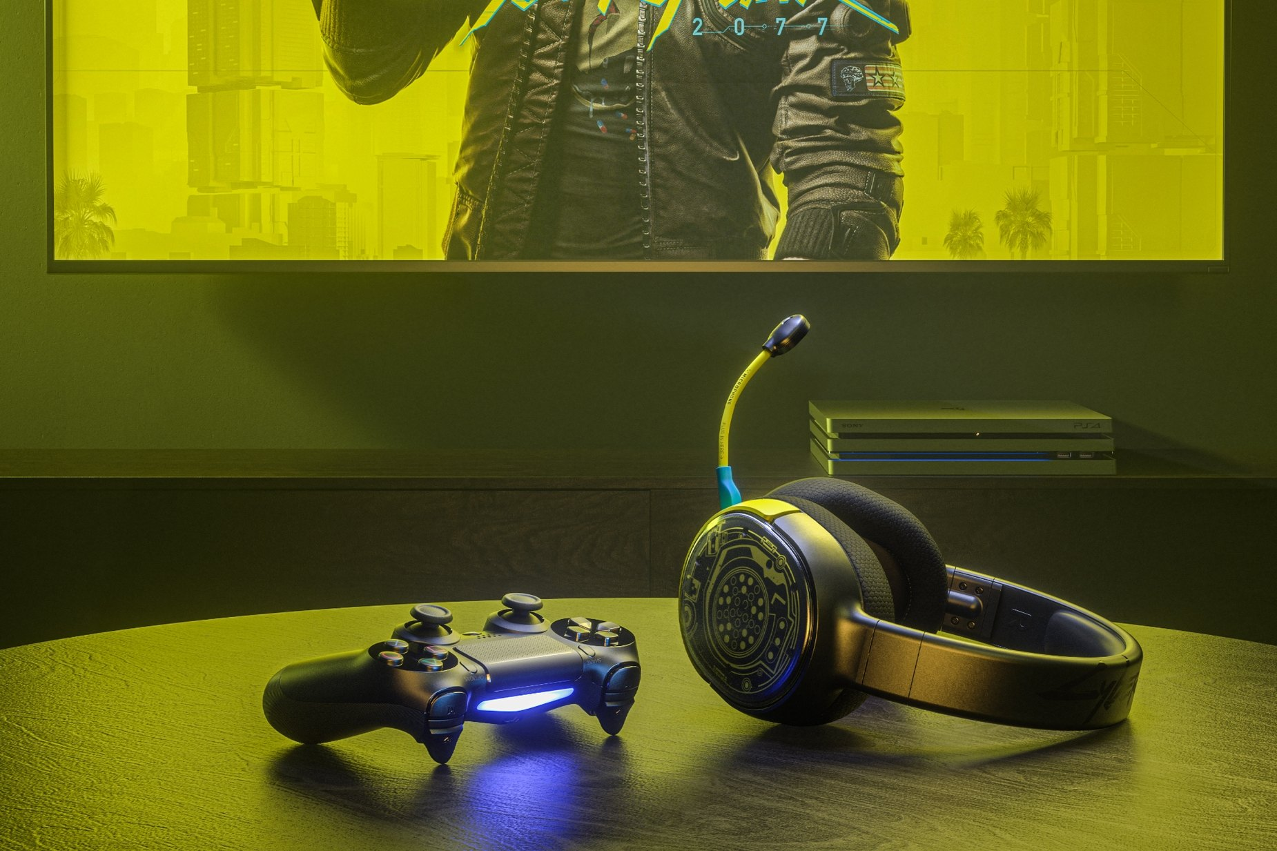 Arctis 1 Wireless Cyberpunk Edition gaming headset on table with a Playstation controller and a PS4 in the background