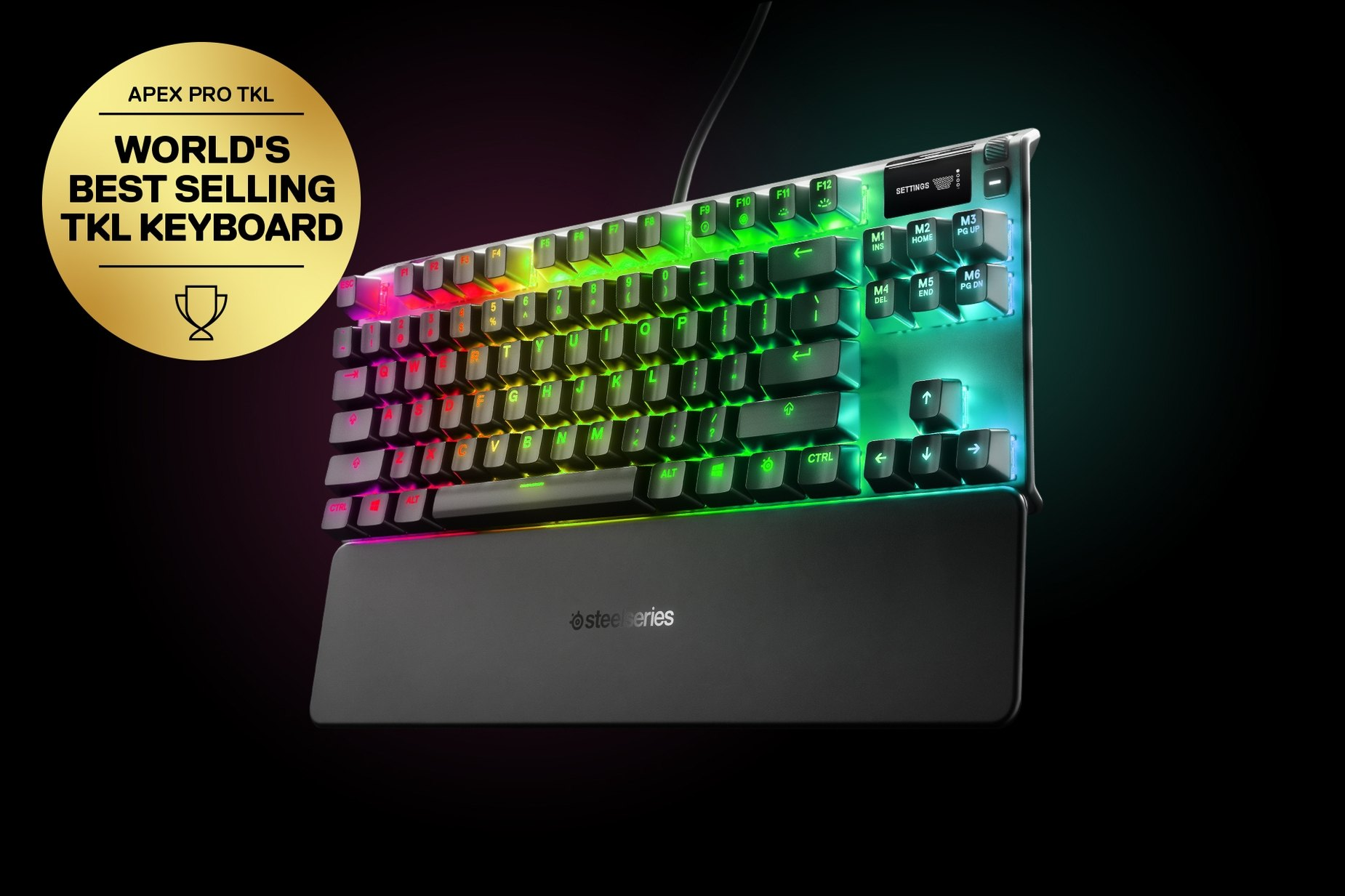 "Немецкий - Apex Pro TKL gaming keyboard with the illumination lit up on dark background, also shows the OLED screen and controls used to change settings, switch actuation, and adjust audio. Keyboard has gold award floating next to it with text ""World's best selling TKL Keyboard""."
