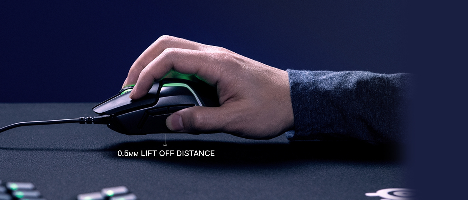 Hand holding Rival 600 gaming mouse showing 0.5mm lift off distance