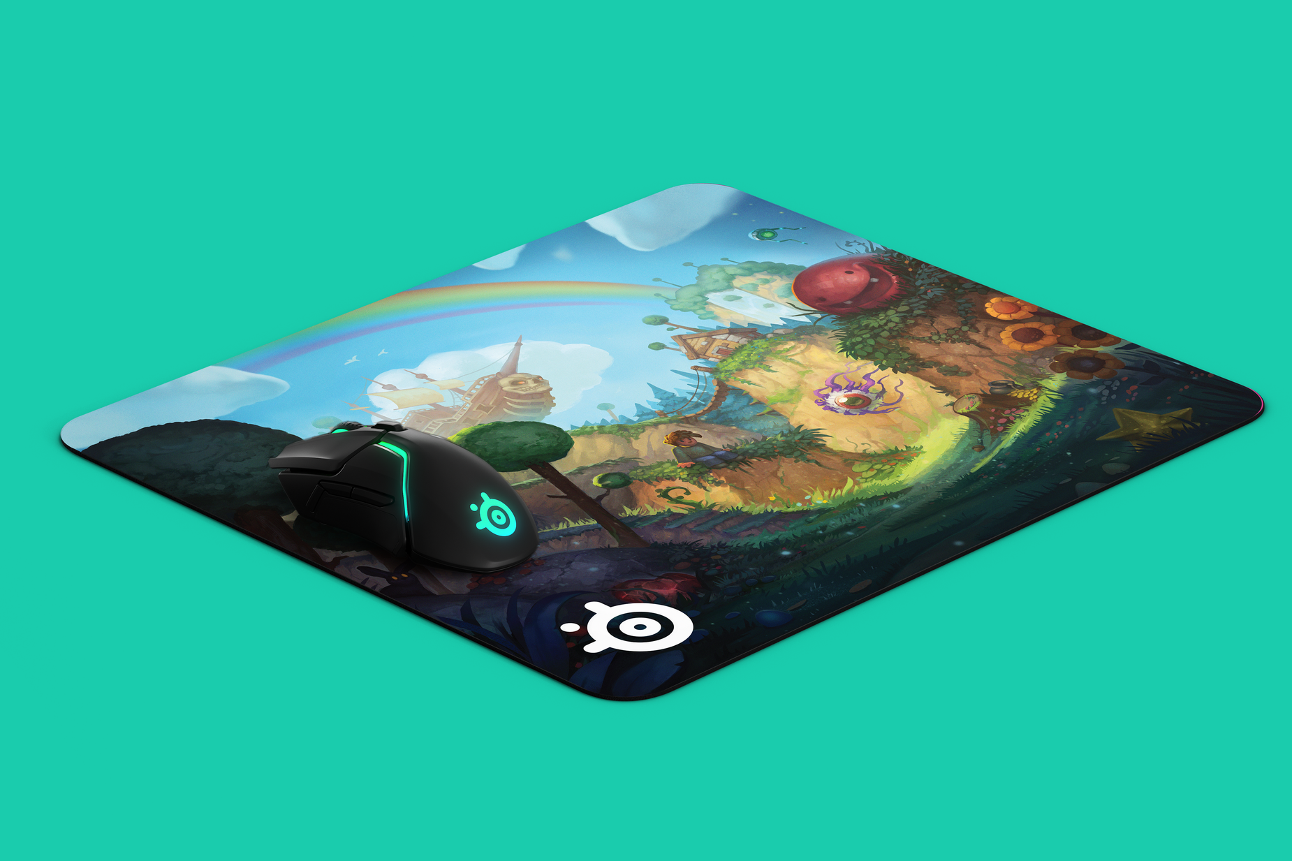 Angled image of mousepad with whimsical creatures in a natural landscape. Computer mouse is placed on mousepad for scale.