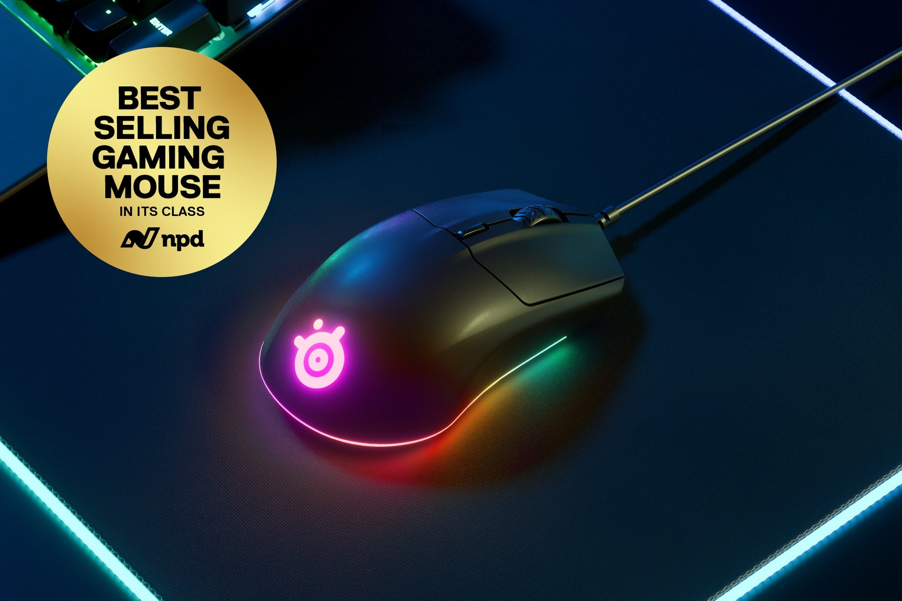 Rival 3 gaming mouse on RGB mousepad. Best selling gaming mouse award from NPD