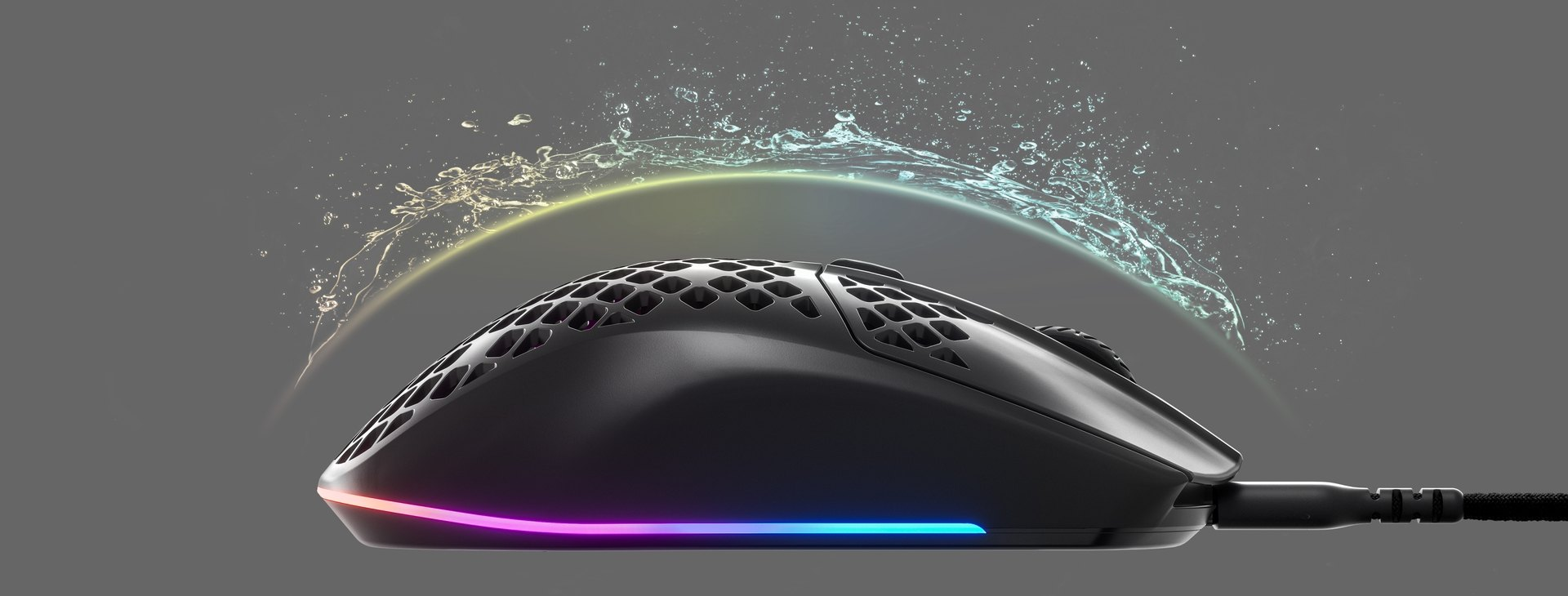 An Aerox 3 mouse with an invisible shield protecting it from incoming water splashing, to convey the waterproofing features