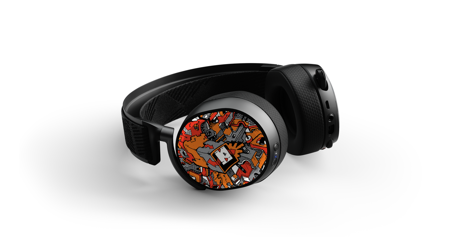 Arctis Pro speaker plates designed by Artist Dune Haggar on a headset laying flat