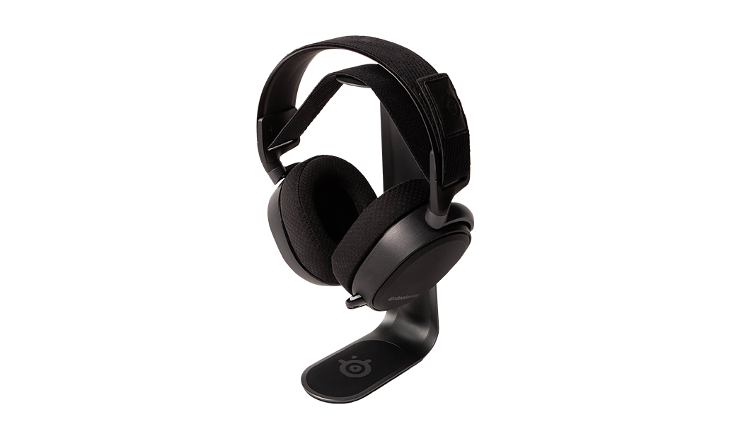 Aluminum headset shown holding Arctis headset