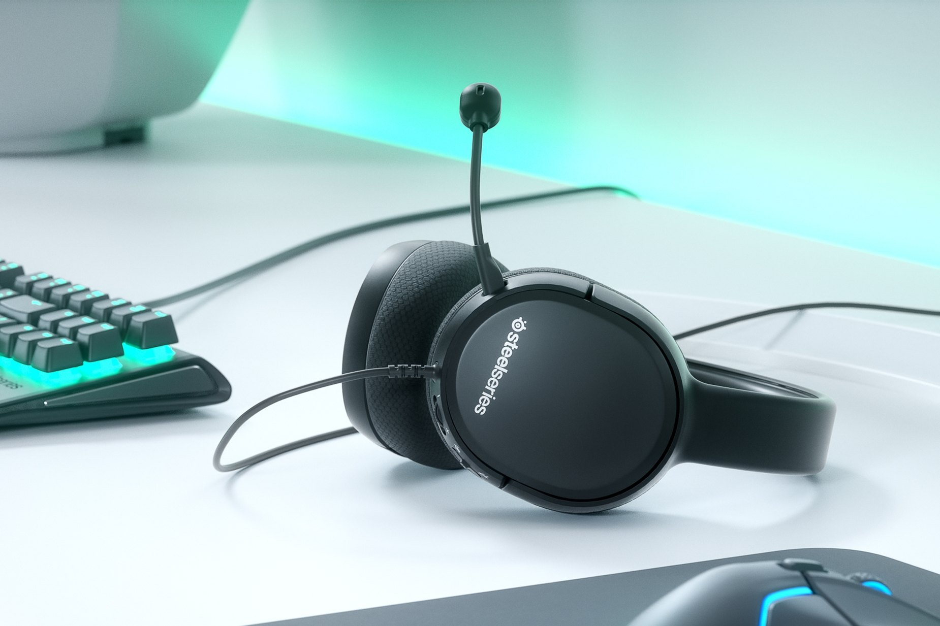 Arctis 1 for Xbox gaming headset on table with Xbox game console next to it.