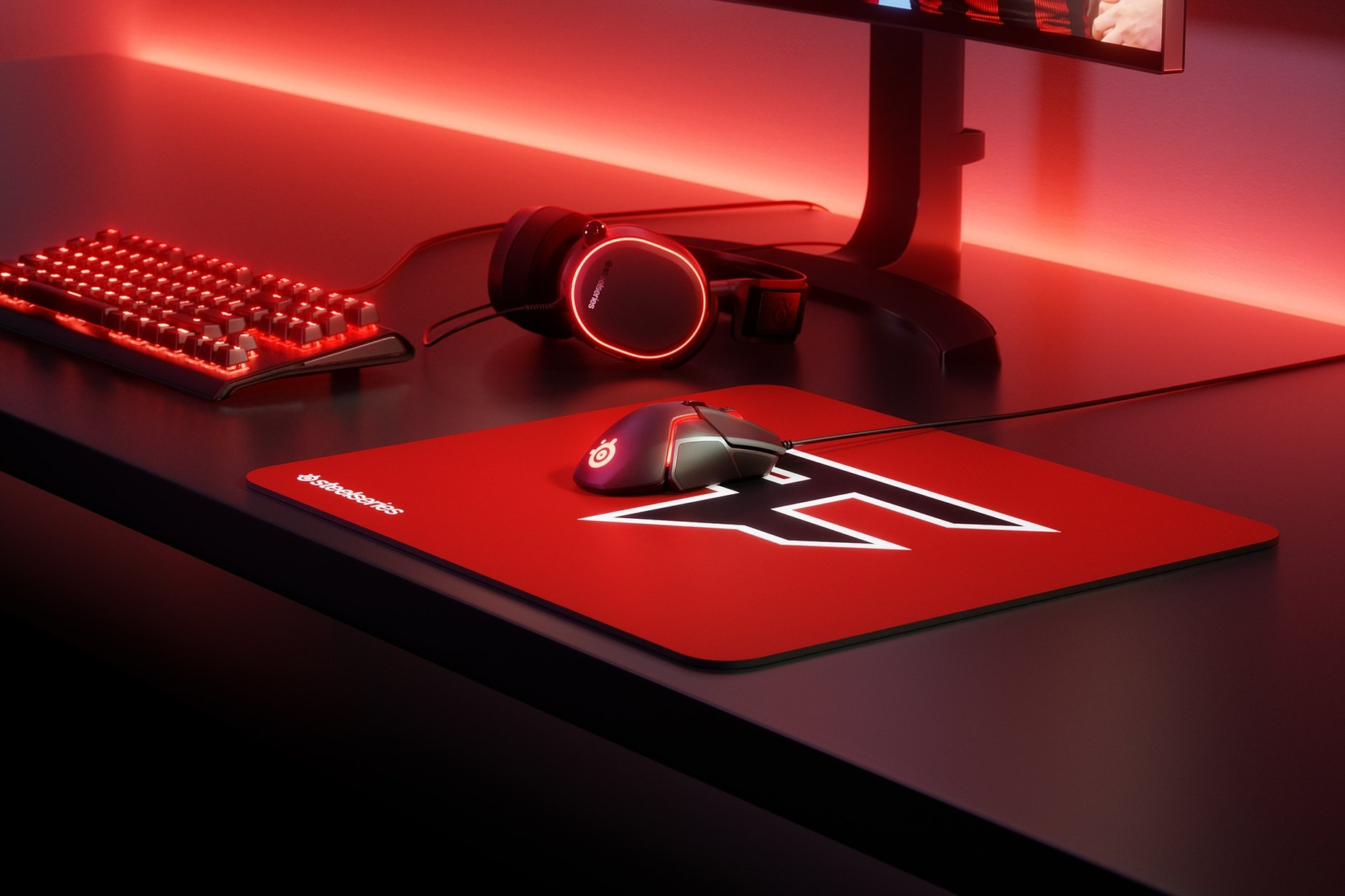 QcK Faze clan edition on desk with mouse, keyboard, and monitor