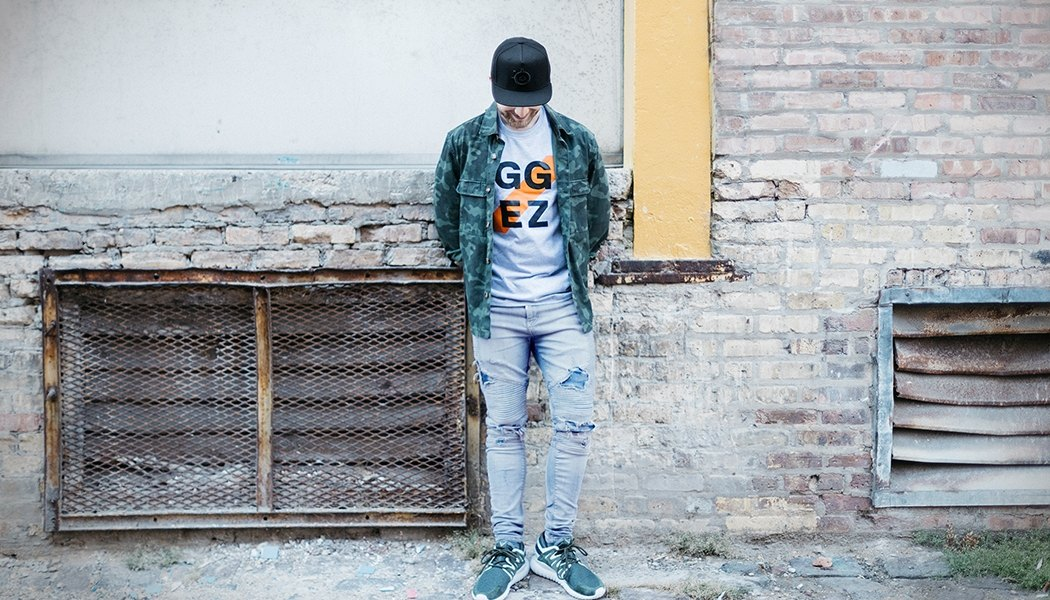 Lifestyle shot of a model wearing the GG EZ t-shirt in his outfit
