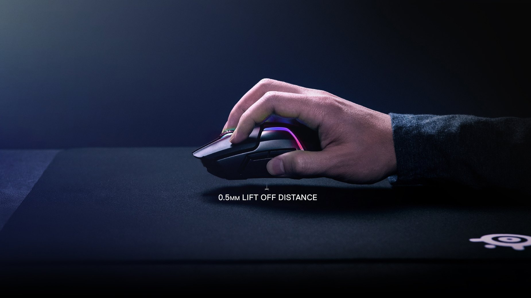 Hand holding Rival 650 Wireless above table to show 0.5mm lift off distance