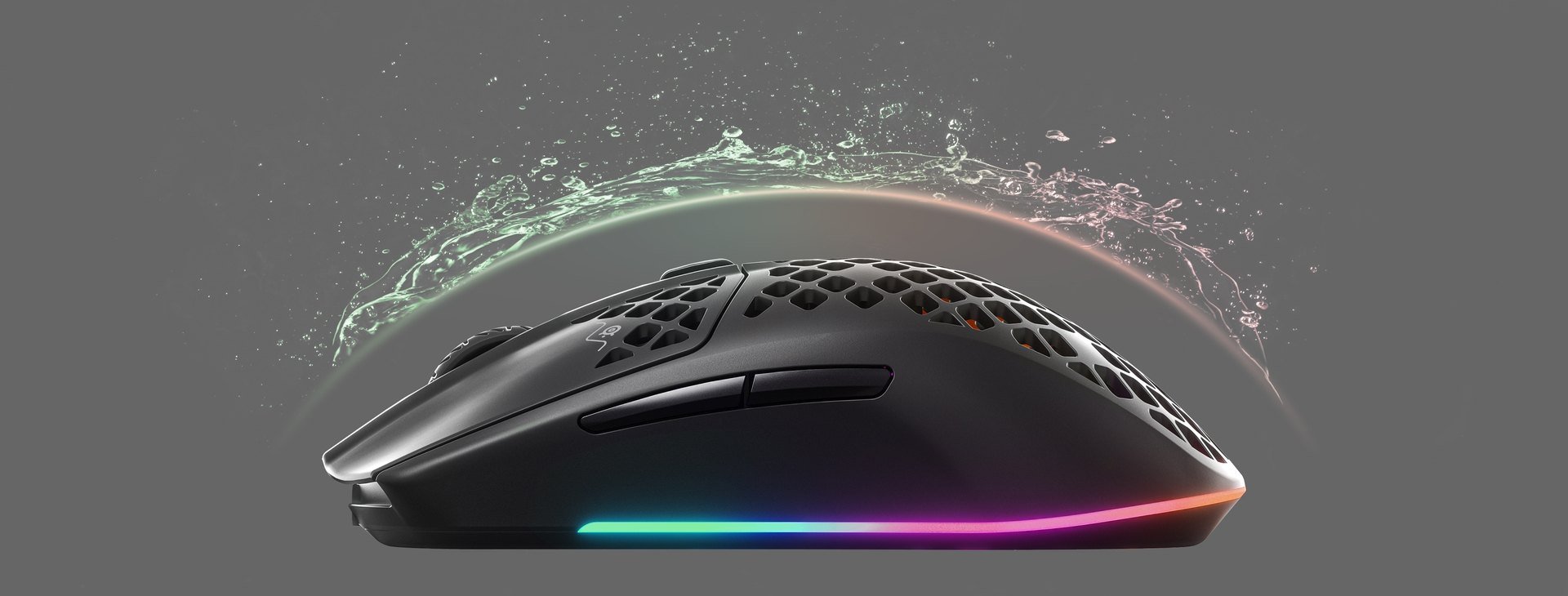 An Aerox 3 Wireless mouse with an invisible shield protecting it from incoming water splashing, to convey the waterproofing features