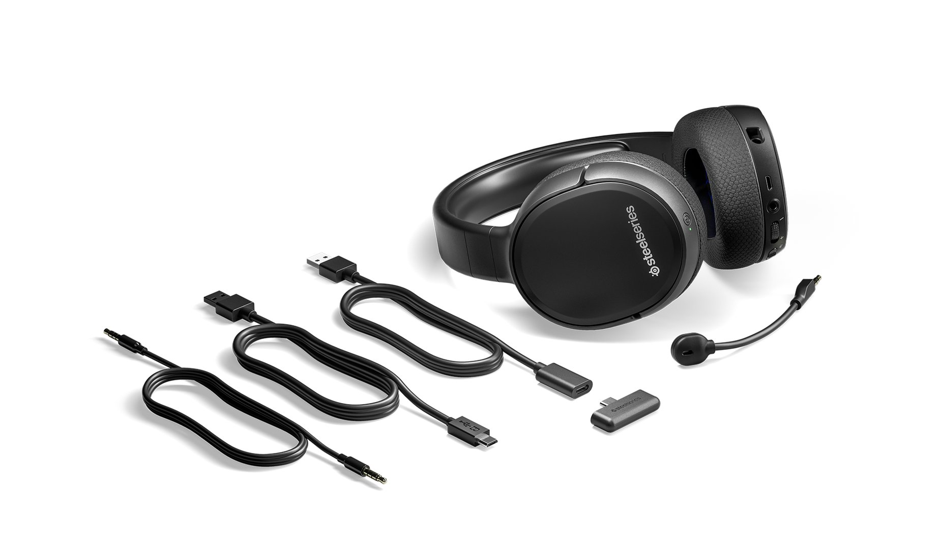 The Arctis 1 Wireless for Switch gaming headset surrounded by all the box contents including extra cables and the wireless dongle