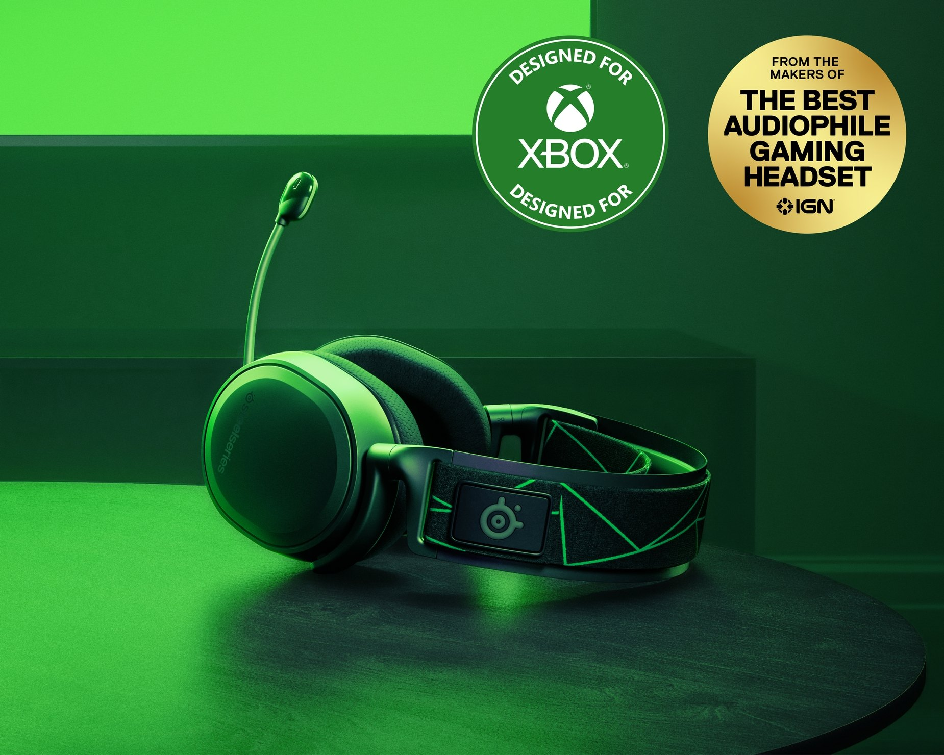 Image of headset laying flat on a table with a signature Xbox color glow visible