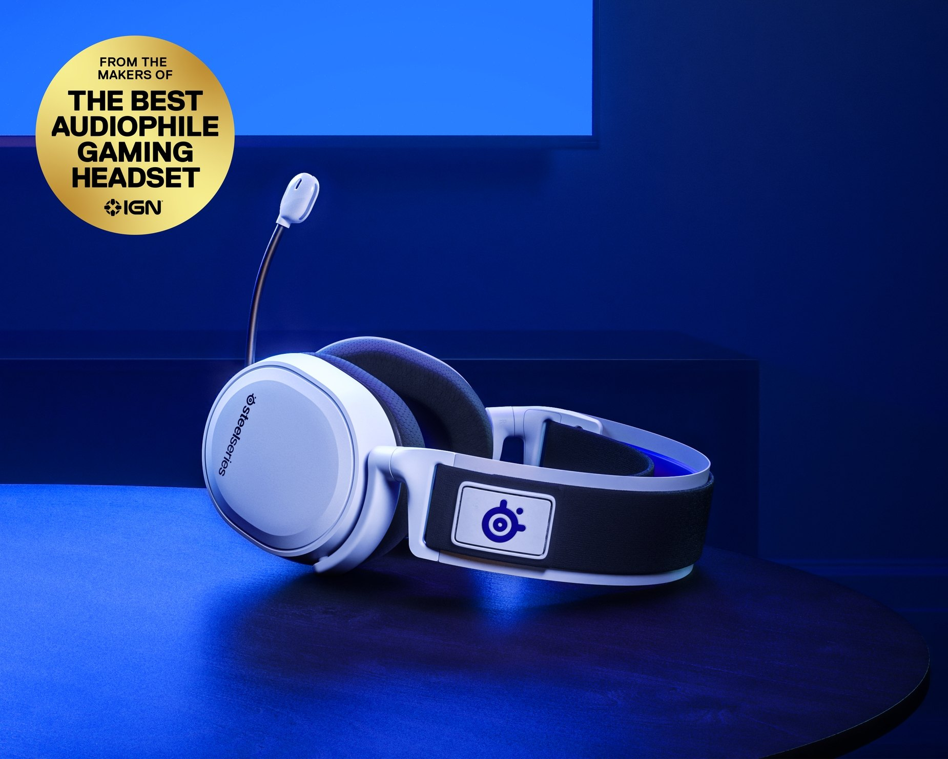 Arctis headset laying flat with microphone extended and PlayStation color hue